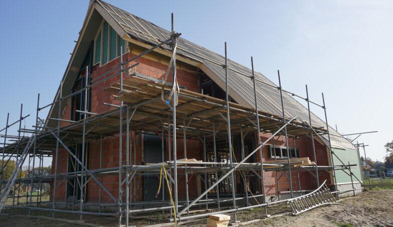 Nieuwe en oude foto's van de bouw van Het Kraakpand te Goor!